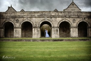 Wedding couple under the Sedbergh School arches, Cumbria.