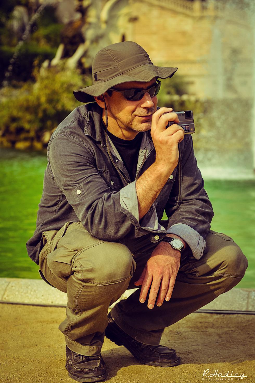 Photographer with waterproof camera in Parc de la Ciutadella, Barcelona