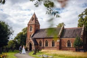 Wedding couple at St. James Church in Weddington, Warwickshire