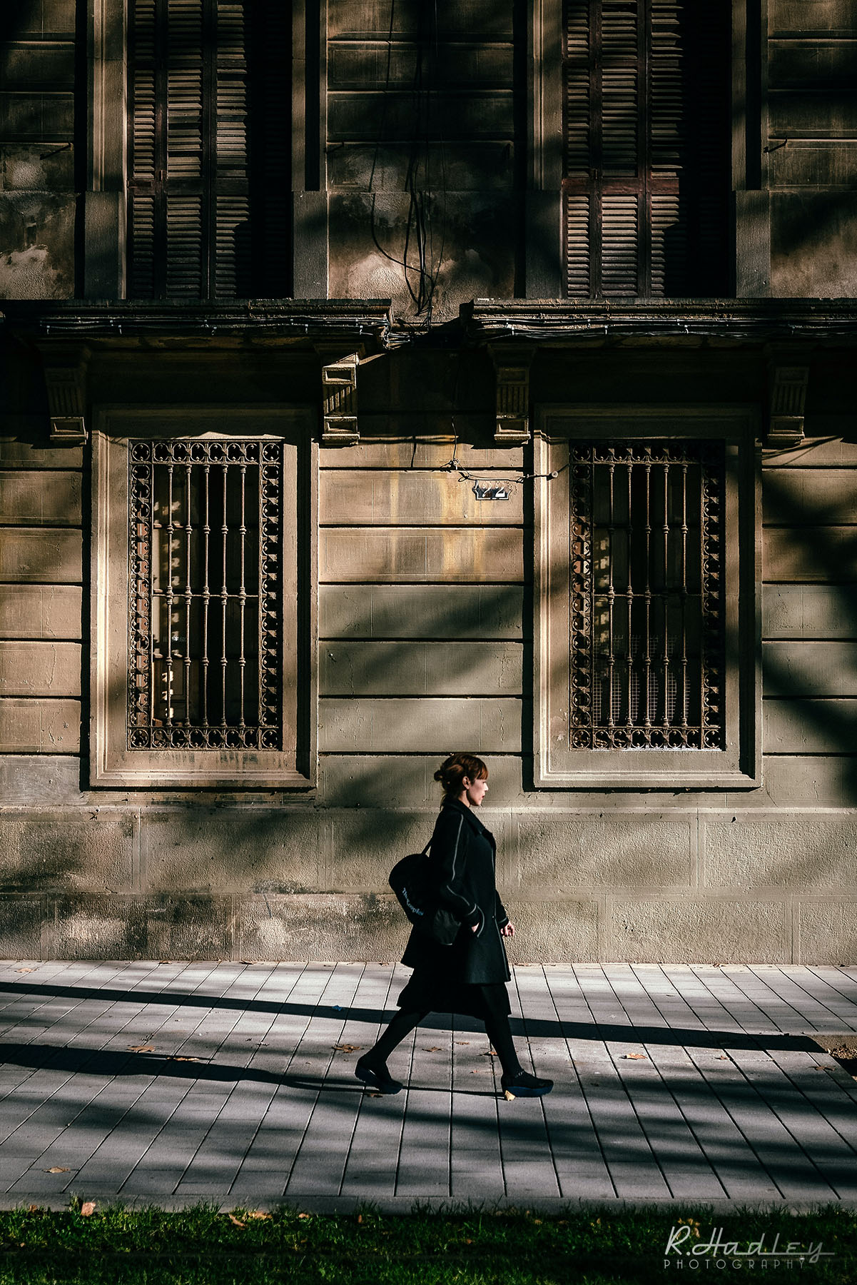 walker on Wellington avenue, Barcelona during a winter/December afternoon light.