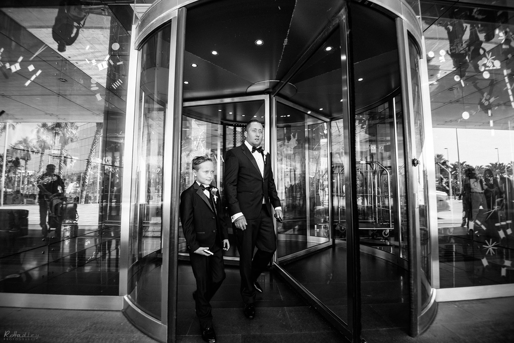 Wedding at the W hotel in Barcelona, Spain. Father and son leaving the hotel.